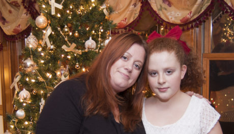 Mother and daughter in front of rememberance tree
